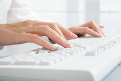 Computer work. Close-up of hand touching computer keys during work Stock Photography