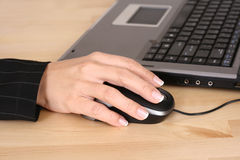 Computer work. Close-ups of mouse and woman hand - computer work Royalty Free Stock Image