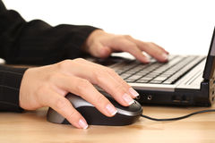 Computer work. Close-ups of woman's hand on laptop - computer work Stock Image