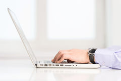 Computer work. Close-up of man typing something on computer Royalty Free Stock Photo