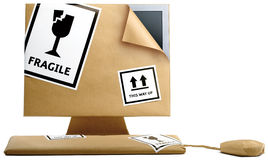 Computer wrapped up in brown paper royalty free stock images