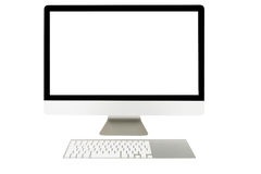 Computeranzeige mit leerem Bildschirm und drahtloser Tastatur Lizenzfreies Stockfoto