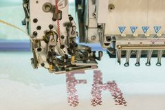 Computerized embroidery machines. sewing machine on blurred background. textile workshop. closeup.  stock images