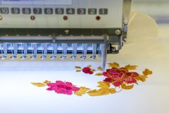 Computerized embroidery machines. sewing machine on blurred background. textile workshop. closeup.  royalty free stock images