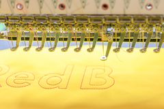 Computerized embroidery machines. sewing machine on blurred background. textile workshop. closeup.  royalty free stock photos