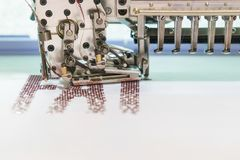 Computerized embroidery machines. sewing machine on blurred background. textile workshop. closeup.  royalty free stock image