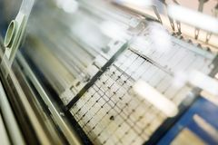 Computerized knitting machines. In textile factory stock image