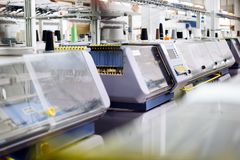 Computerized knitting machines. In textile factory royalty free stock photos