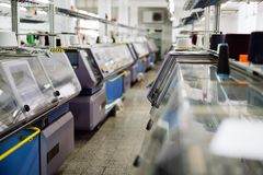 Computerized knitting machines. In modern textile factory stock images