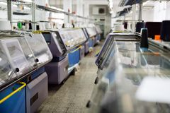 Computerized knitting machines. In modern textile factory stock photo