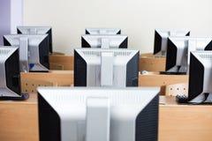 Computers Arranged On Desks In Classroom Stock Photos