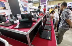 Computers. Citizens see the computers in an exhibition in the city of Solo, Central Java, indonesia stock photography