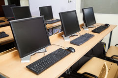 Computers On Desks In Classroom. Row of computers on desks in classroom Stock Images