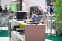 Computers at fair stand Stock Photos