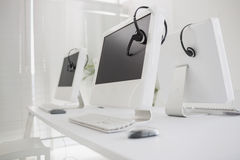Computers and headsets Stock Image