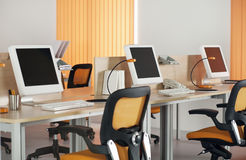 Computers  in modern office. Computers with LCD screens in modern office Royalty Free Stock Photography