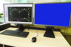 Computers and monitors with schematic diagram for supervisory, control and data acquisition. In modern electrical control room stock photos