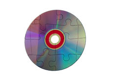 Computers puzzling. Computers can be so puzzling as shown by a disk in pieces Stock Photo