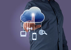 Computing concept. Close up of businessman touching cloud icon with finger Royalty Free Stock Photography