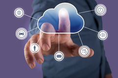 Computing concept. Close up of businessman touching cloud icon with finger Stock Photography