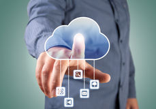Computing concept. Close up of businessman touching cloud icon with finger Stock Photos