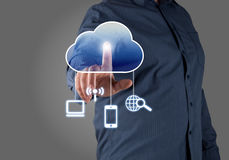 Computing concept. Close up of businessman touching cloud icon with finger Stock Photo