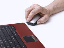 Computing. Elderly person's hand on a mouse Royalty Free Stock Image