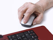 Computing. Elderly person's hand on a mouse Royalty Free Stock Images