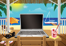 Computing in holiday beach hut Stock Photo