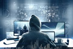 Computing and theft concept. Hacker using computer with digital business interface royalty free stock photography