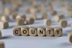 Comté - cube avec des lettres, signe avec les cubes en bois Photo stock