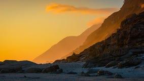Comtemplación de puesta del sol foto de archivo