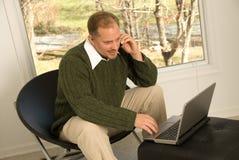 Comunicações empresariais no escritório home Foto de Stock