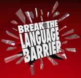 Comunicación de la traducción de la barrera linguística de la rotura Imagen de archivo libre de regalías