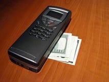 Comunicador y $100 cuentas Imágenes de archivo libres de regalías