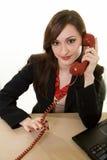 Comunicando su un vecchio telefono fotografia stock