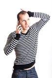 Comunicando sul cellulare Immagini Stock