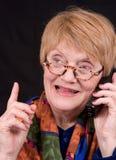 Comunicando sul telefono Immagini Stock Libere da Diritti
