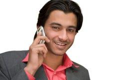 Comunicando sul telefono delle cellule Immagine Stock Libera da Diritti