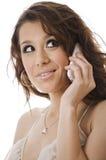 Comunicando sul telefono mobile Immagine Stock