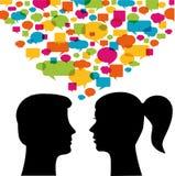 Comunicazione della donna e dell'uomo Immagine Stock