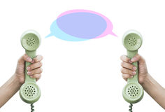 Comunicazione Telefono della tenuta della mano retro Immagini Stock Libere da Diritti