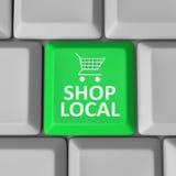 Comunidad de la ayuda del carro de la compra de la llave de equipo local de la tienda Foto de archivo libre de regalías