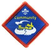 A comunidade - emblema da atividade do escuteiro fotos de stock