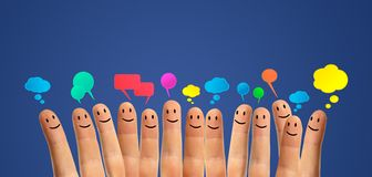 Comunique los smiley del dedo Imagen de archivo
