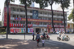 Comunist youth headquarter. Comunist youth organization headquarter building in Ho Chi Minh city in Vietnam decorated with party slogans Stock Photos