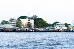 Comunità della riva del fiume Immagini Stock Libere da Diritti