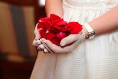 Comunnion med röda petals Royaltyfri Bild