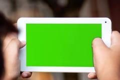 Comupter lindo de la tableta de la tenencia del adolescente Imagen de archivo