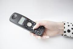 Con el brazo del microteléfono Imagen de archivo libre de regalías